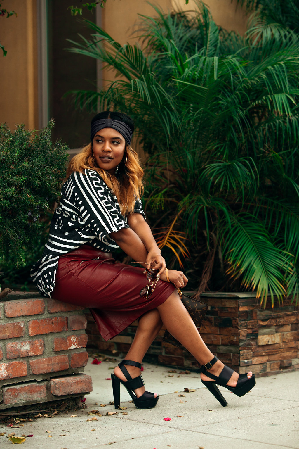 Perched on brick in Long Beach -- http://thehautemommie.com/black-girl-magic/