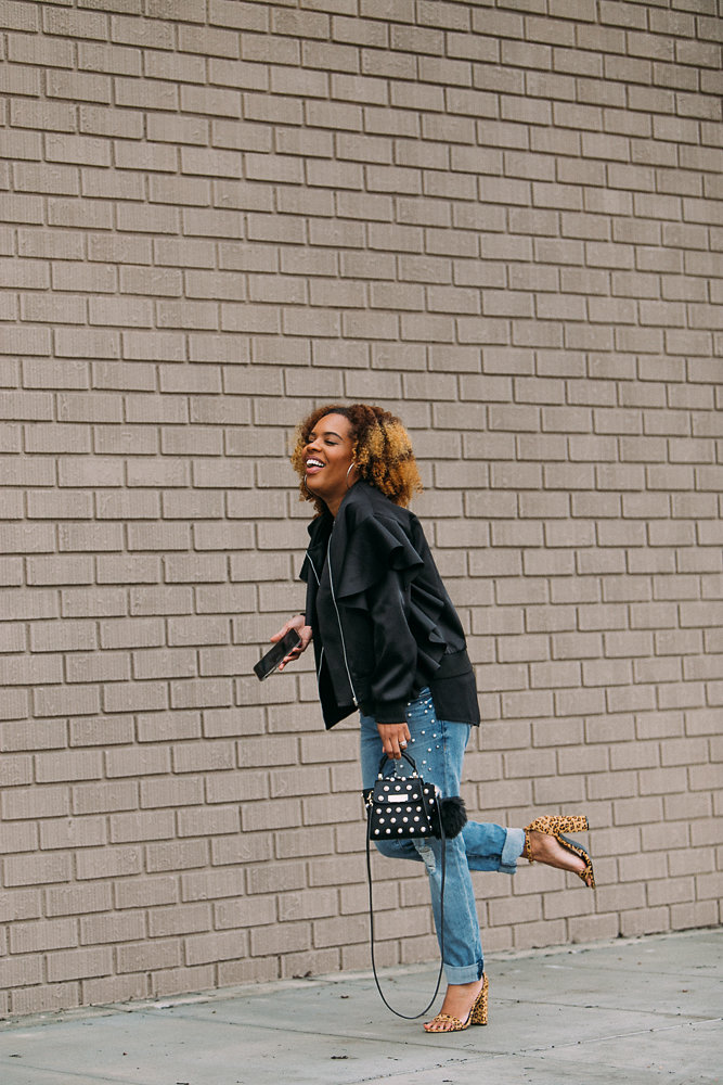 Hautemommie wears pearl embellished jeans and bomber jacket with leopard heels