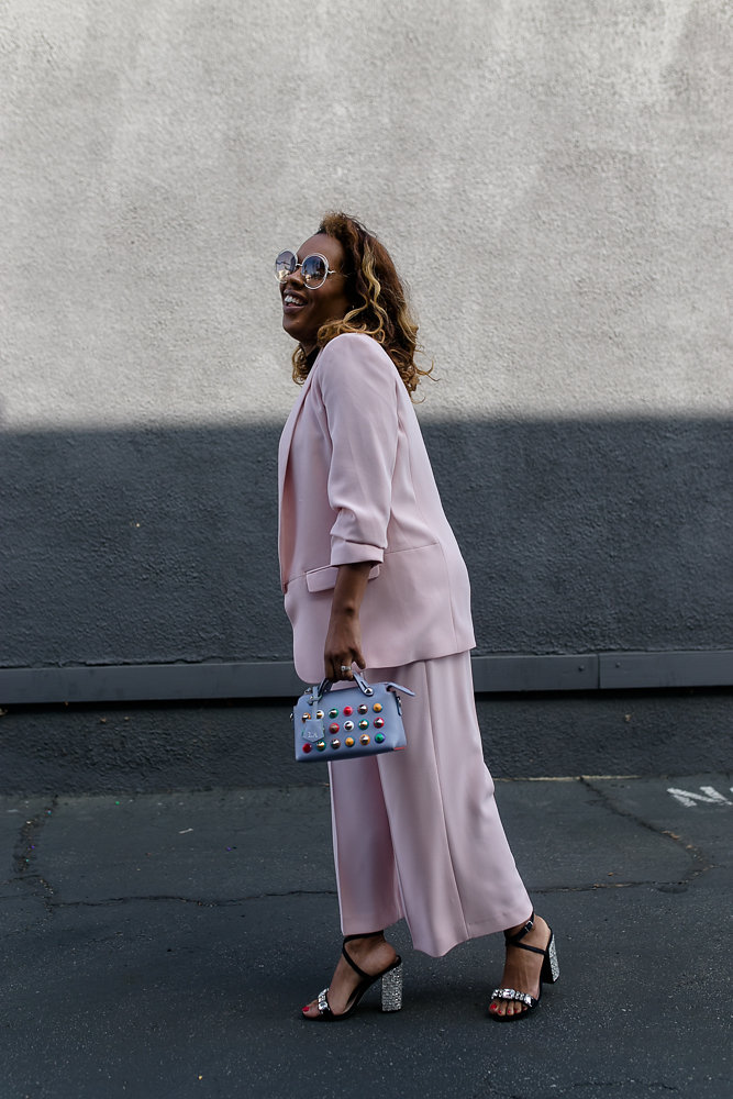 Hautemommie wears Zara pink two piece with Fendi bag
