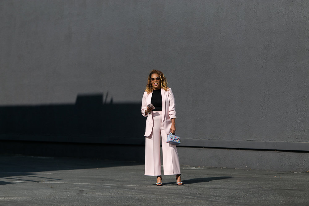 Hautemommie is all smiles in millennial pink suit