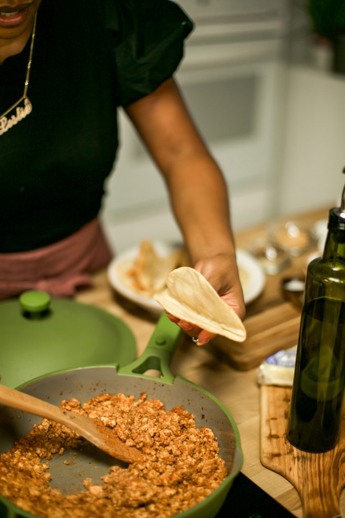 Leslie shows readers how to properly fill a taco shell for her chorizo tofu tacos.