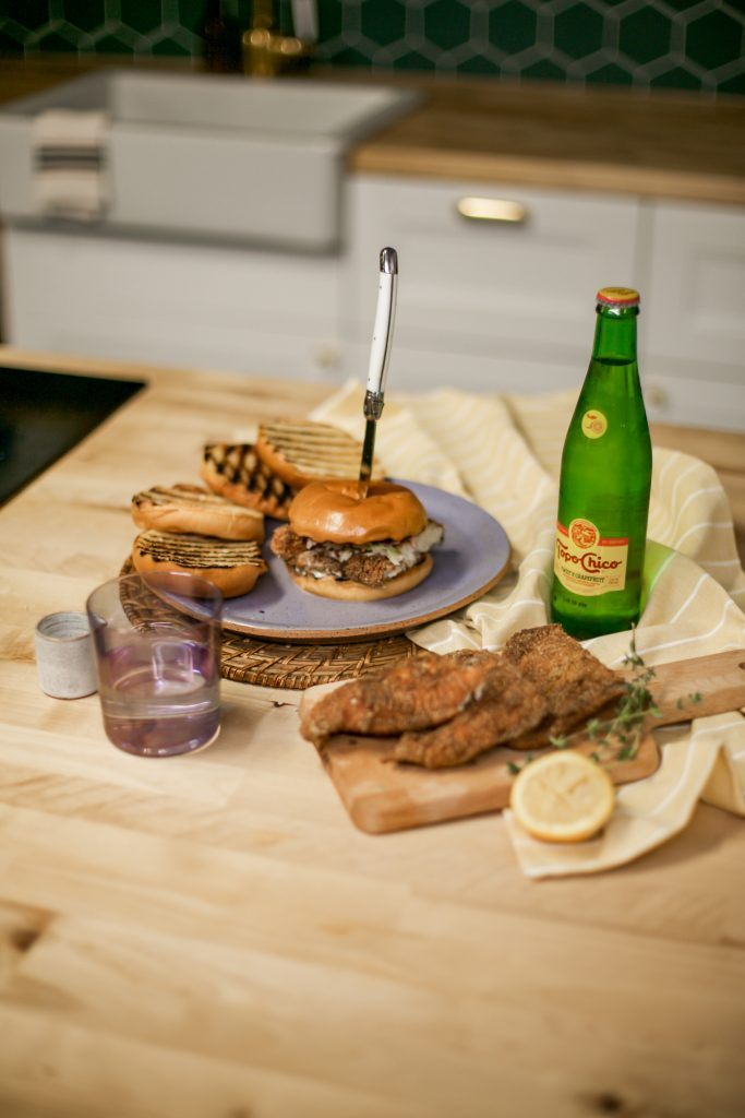 Photo of Fried Catfish Sandwich accompanied by Topo Chico from celebrity home cook and media personality, Leslie Antonoff!