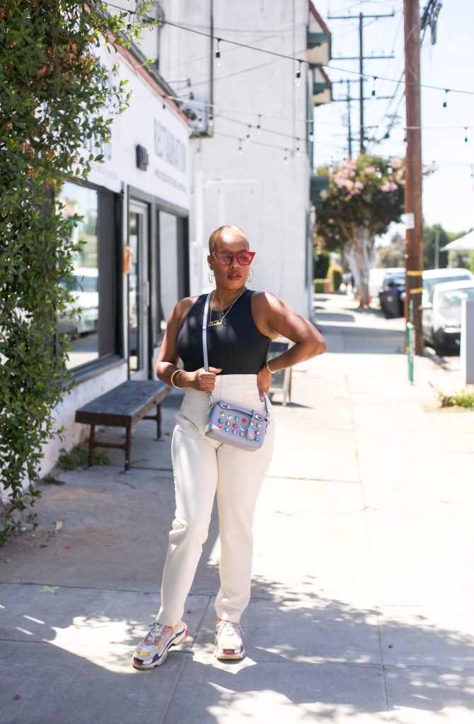 Black woman, Leslie Antonoff stands for photo in Long Beach, Ca.